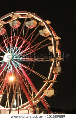 Ferris observation wheel at night - stock photo