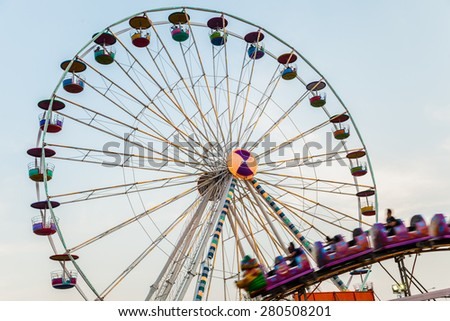 ferris wheel against a blue sky - stock photo