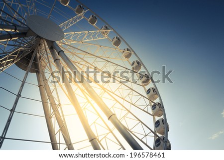 ferris wheel against a blue sky background - stock photo
