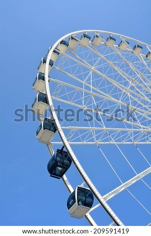 Ferris Wheel against a bright blue sky  - stock photo