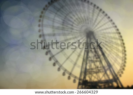 ferris wheel against a  sky twilight and bokeh backgroung - stock photo