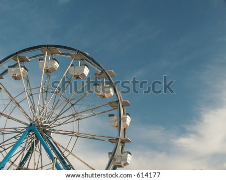 ferris wheel against a sky with clouds