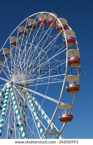 Ferris Wheel against blue sky background - stock photo