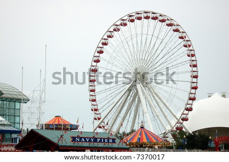 ferris wheel against cloudy sky in Navy Pier Chicago