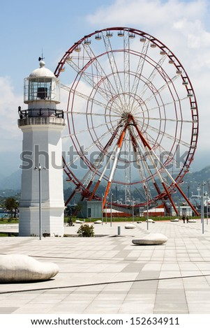 Ferris wheel and lighthouse at the coastline of Batumi, Georgia