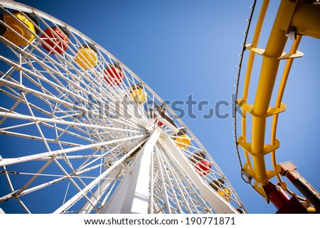 Ferris Wheel and Roller Coaster - stock photo
