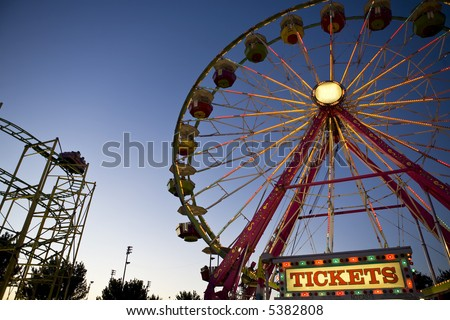 Ferris Wheel and Roller Coaster at Night and the county fair