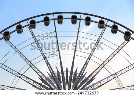 Ferris Wheel at amusement park. - stock photo