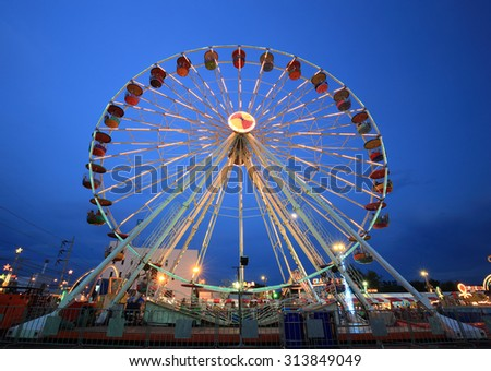 Ferris Wheel at amusement park at twilight time