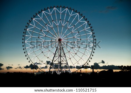 Ferris wheel at dusk - stock photo