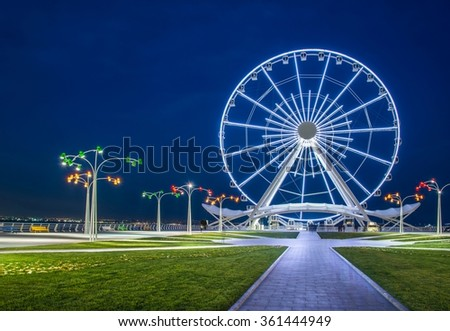 Ferris wheel at sea boulevard in Baku Azerbaijan - stock photo