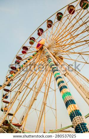 ferris wheel at sunrise - stock photo
