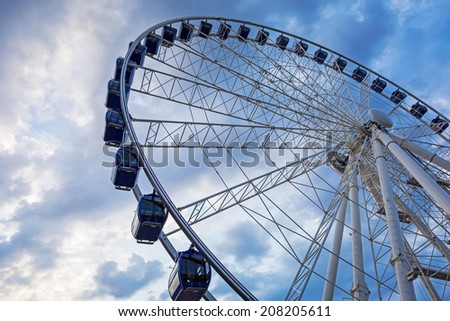 Ferris wheel at sunset in Gdansk, Poland - stock photo