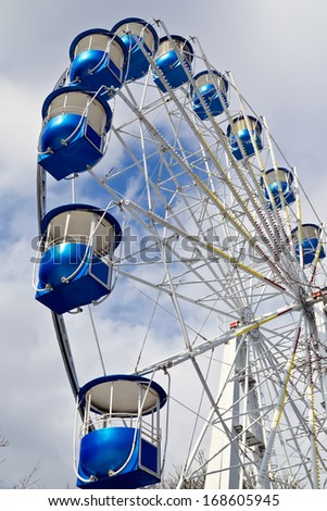 Ferris wheel at the background of the blue sky