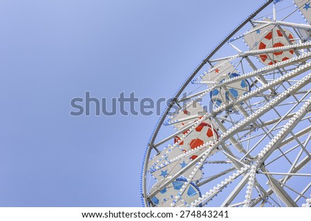 Ferris Wheel at the county fair with the sky in the background