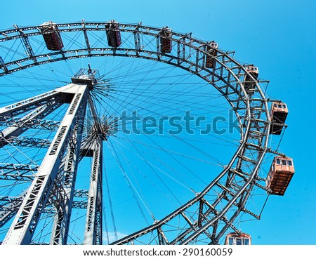Ferris wheel at the entrance of the Prater amusement park in Vienna. Austria - stock photo