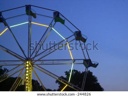 Ferris wheel at twilight. - stock photo
