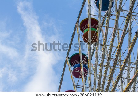 Ferris Wheel at with the sky in the background - stock photo