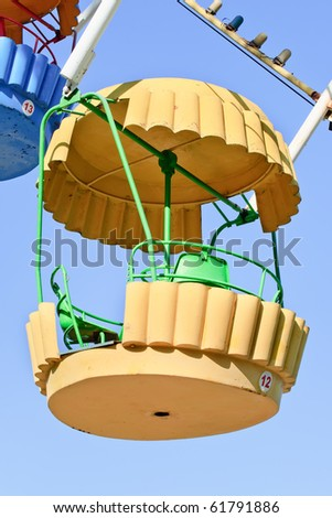 Ferris wheel cabin on a blue sky background - stock photo