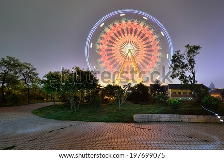 Ferris wheel during Children's Day in the city center of Nanning, Guangxi, China. - stock photo