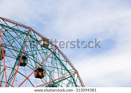 Ferris wheel. Fair, summer, vacation, travel and attractions concept - stock photo