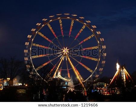 Ferris wheel illuminated at night