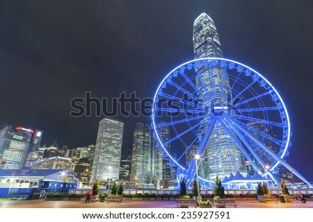 Ferris Wheel in Hong Kong City at dusk - stock photo