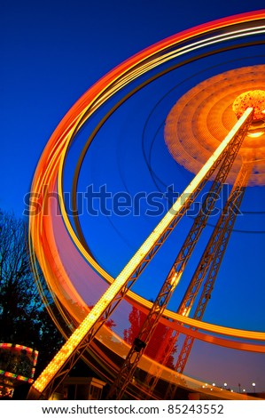 Ferris wheel in motion at night in the luna park - stock photo