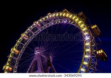 Ferris wheel in Prater, Vienna. Wiener Riesenrad in Prater park, Austria. Giant Ferris Wheel at night in Prater Park. Lighting Ferris Wheel in Vienna. Illumination ferris wheel in night.  - stock photo