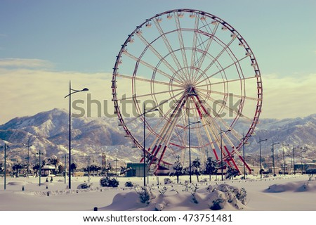 Ferris wheel in the snow. The Georgian Black Sea coast in winter