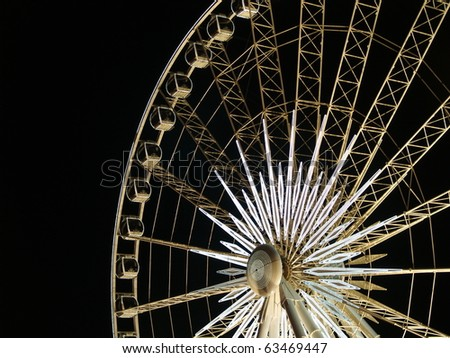 Ferris wheel lit up in  Niagara Falls, Ontario, Canada. - stock photo