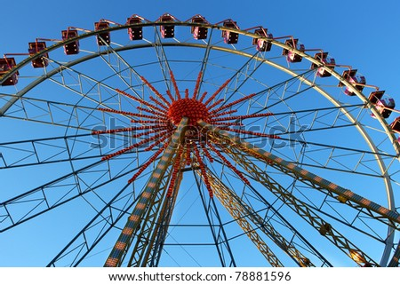 ferris wheel on a sunny day - stock photo