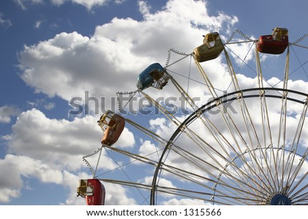 Ferris Wheel on  Beautiful Sky Background - stock photo