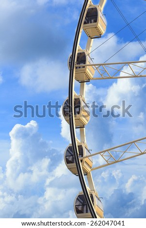 Ferris wheel on blue sky - stock photo