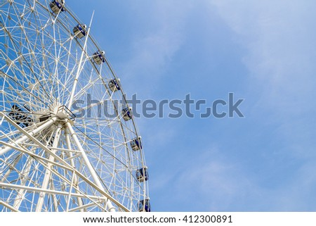 ferris wheel on blue sky and white cloud - stock photo