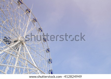 ferris wheel on blue sky and white cloud with color filter - stock photo