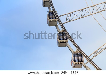 Ferris Wheel on blue sky background. - stock photo