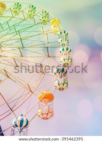 Ferris Wheel on Blue Sky, vintage filter effect,double exposure stylized  - stock photo