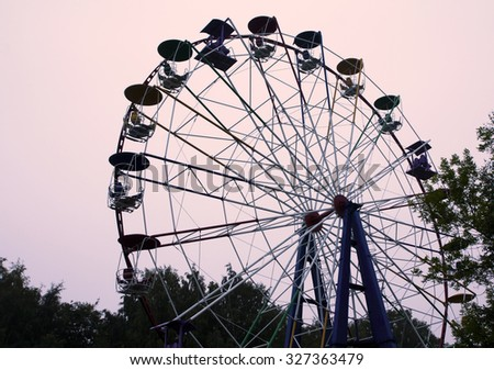 Ferris wheel on dark sky background