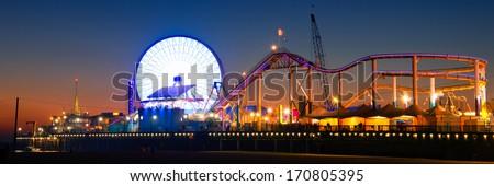 Ferris wheel on Santa Monica Pier lit up at dusk, Santa Monica, Los Angeles County, California, USA - stock photo