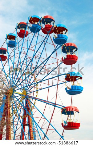 Ferris wheel on the blue sky background - stock photo