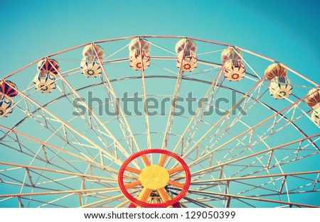 Ferris Wheel Over Blue Sky - stock photo