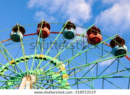 Ferris wheel over blue sky background - stock photo