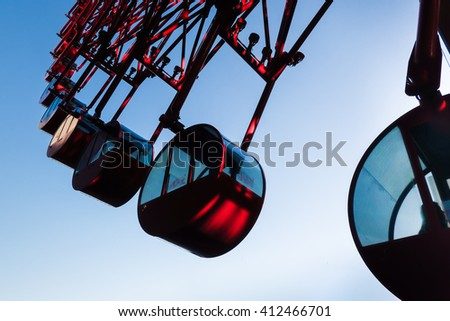 Ferris Wheel Over Blue Sky in evening  - stock photo