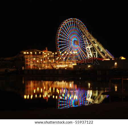 Ferris wheel reflected in a flooded beach