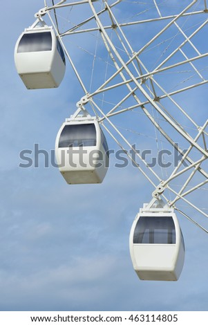 Ferris wheel white color on blue sky