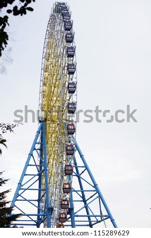 Ferris wheel with different color cabins in Tbilisi, Georgia