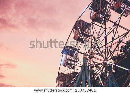 ferris wheel with sunset ,Thailand - stock photo