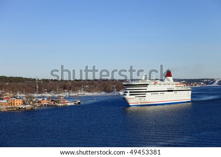 Ferry affecting at a port in Stockholm, Sweden.