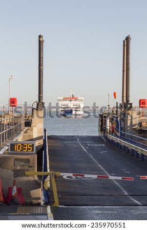 Ferry arriving at Dock - stock photo
